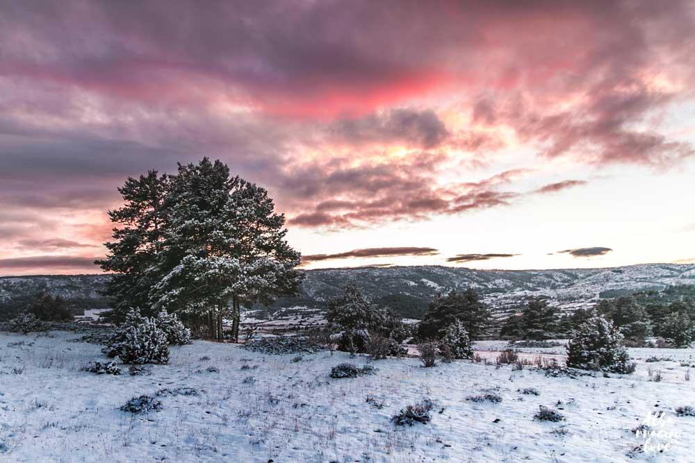 Fotografía de Puesta de sol con el paisaje nevado